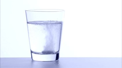 152354841-hangover-effervescent-tablet-headache-water-glass.jpg